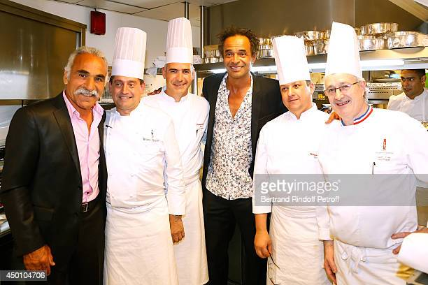 Former tennis players Yannick Noah Mansour Bahrami Chef JeanYves Leuranguer and his team attend the Legends of Tennis Dinner Held at Restaurant...