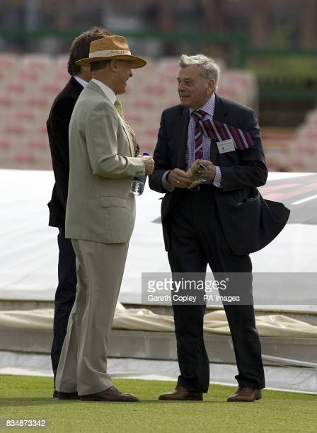 Former test umpire Dickie Bird chats with Geoffrey Boycott on the wicket before the start of the day's play