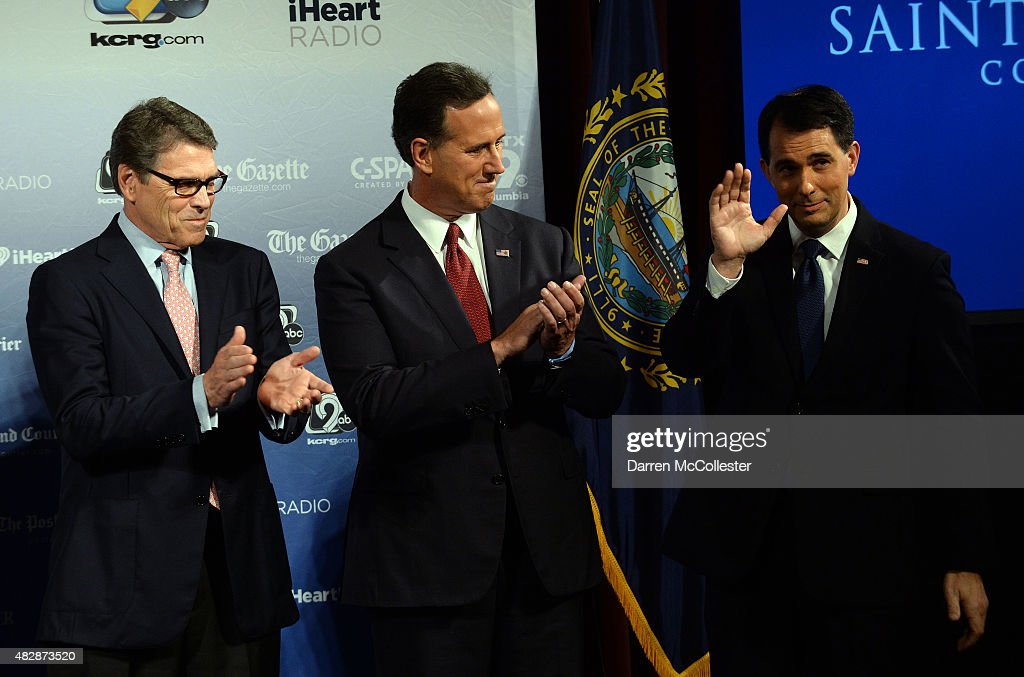 Former Texas Gov. Rick Perry, former U.S. Sen. Rick Santorum (PA) and Wisconsin Gov. Scott Walker stand on the stage prior to the Voters First Presidential Forum for Republicans at Saint Anselm College August 3, 2015 in Manchester, New Hampshire. The forum was organized by the New Hampshire Union Leader newspaper and C-SPAN in response to the Fox News debate later this week that will limit the candidates to the top 10 Republicans based on nationwide polls.