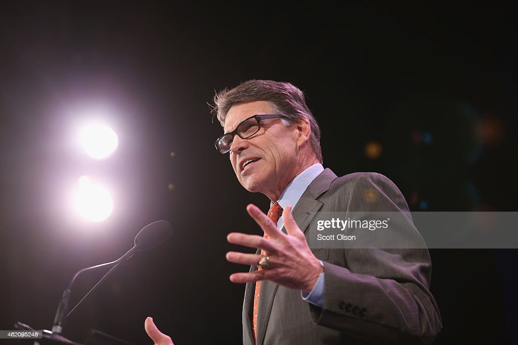 Former Texas Governor Rick Perry speaks to guests at the Iowa Freedom Summit on January 24 2015 in Des Moines Iowa The summit is hosting a group of...