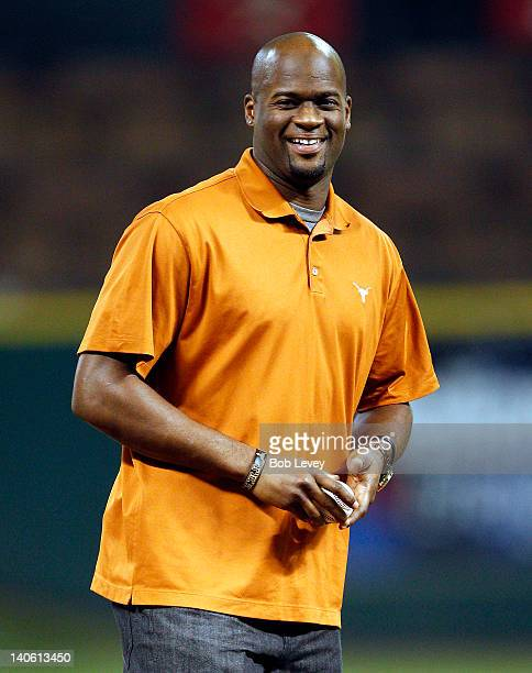 Former Texas Longhorn quarterback Vince Young throws out the first pitch before the Texas Longhorns play the Rice Owls during the Houston College...