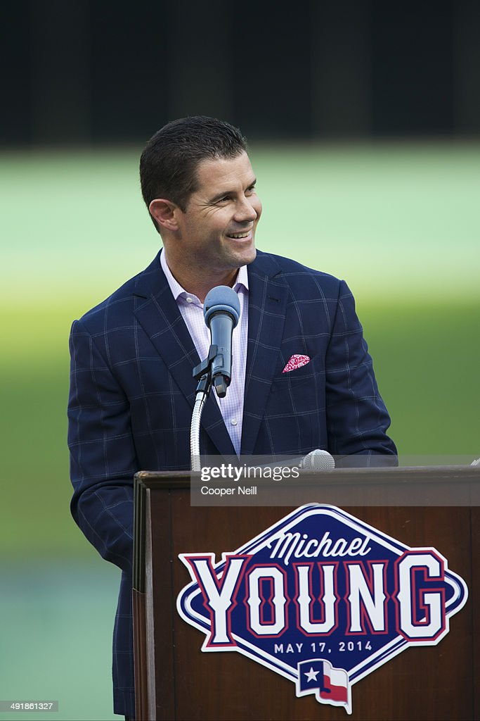 Former Texas Ranger Michael Young is honored before play begins between the Texas Rangers and the Toronto Blue Jays on May 17 2014 at Globe Life Park...