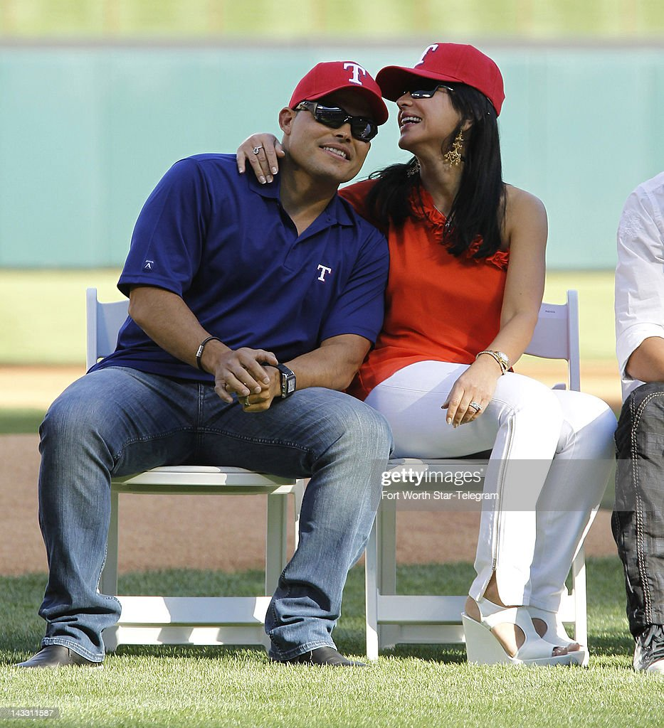 Former Texas Rangers catcher Ivan Rodriguez and his wife, Claudia, listen during a video tribute in the pregame ceremony honoring his career before the Rangers game with the New York Yankees at Rangers Ballpark in Arlington, Texas, Monday April 23, 2012.