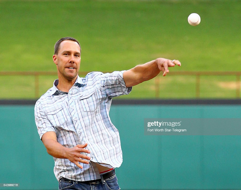 Former Texas Rangers player David Murphy throws out the ceremonial first pitch before a game against the Boston Red Sox at Globe Life Park in Arlington, Texas, on Friday, June 24, 2016.