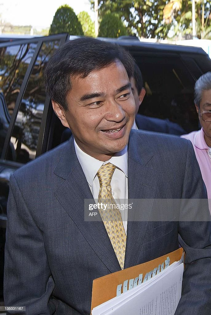 Former Thai prime minister <a gi-track='captionPersonalityLinkClicked' href=/galleries/search?phrase=Abhisit+Vejjajiva&family=editorial&specificpeople=645779 ng-click='$event.stopPropagation()'>Abhisit Vejjajiva</a> smiles as he arrives for questioning at the Bangkok Metropolitan Police headquarters on December 9, 2011. Abhisit, now opposition leader, reported to police on December 9 for questioning over a deadly military crackdown he oversaw on mass opposition protests in Bangkok last year. More than 90 people, mostly civilians, were killed and nearly 1,900 were wounded during the April and May 2010 rallies, which drew about 100,000 'Red Shirt' demonstrators at their peak. AFP PHOTO/Joan Manuel BALIELLAS
