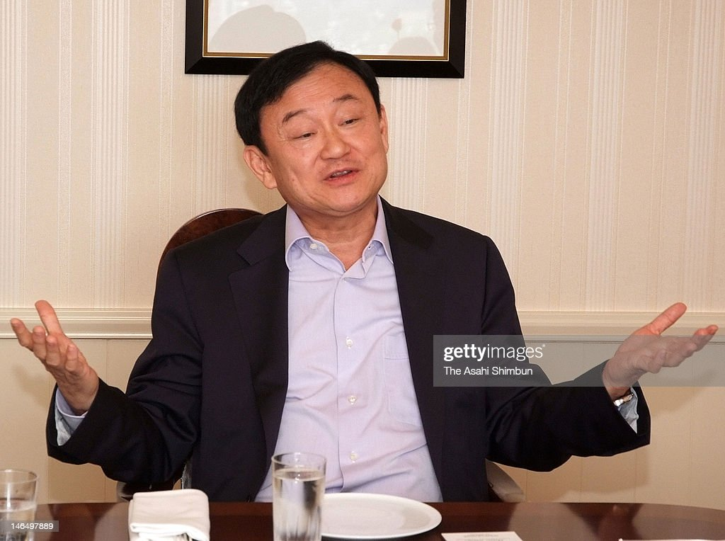 Former Thai Prime Minister <a gi-track='captionPersonalityLinkClicked' href=/galleries/search?phrase=Thaksin+Shinawatra&family=editorial&specificpeople=220948 ng-click='$event.stopPropagation()'>Thaksin Shinawatra</a> speaks during a press conference at the Imperial Hotel on June 16, 2012 in Tokyo, Japan. Thaksin is in the 2-day visit to Japan to enhanse the bilateral economic partnerships.