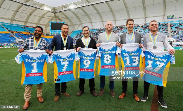 Former titan players who were named in the team of the decade pose for a photograph during the round 14 NRL match between the Gold Coast Titans and...