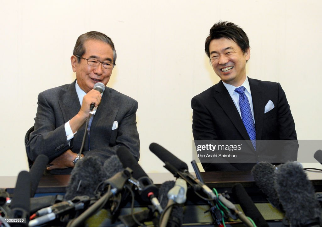 Former Tokyo governor <a gi-track='captionPersonalityLinkClicked' href=/galleries/search?phrase=Shintaro+Ishihara&family=editorial&specificpeople=665335 ng-click='$event.stopPropagation()'>Shintaro Ishihara</a> and Osaka City mayor <a gi-track='captionPersonalityLinkClicked' href=/galleries/search?phrase=Toru+Hashimoto&family=editorial&specificpeople=4847016 ng-click='$event.stopPropagation()'>Toru Hashimoto</a> attend a press conference on the merger of the Sunrise Party and Japan Restoration Party on November 17, 2012 in Osaka, Japan. Ishihara's party will be dissolved and merge to Hashimoto's Japan Restoration Party, Ishihara will be appointed as new president of the party and Hashimoto will be their acting president, and will seek more coalitions with small parties eyeing on December 16 general election.
