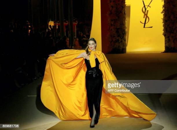 Former top model Carla Bruni presents a creation for French designer Yves Saint Laurent 22 January 2002 during the retrospective part of Saint...