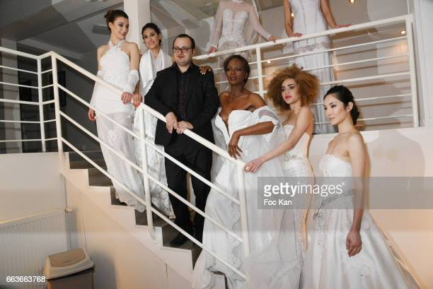 Former Top model Rebecca AyokoÊ designer Georges Bedran and models walk the runway during Georges Bedran Fashion Show at Espace Batignolles on April...