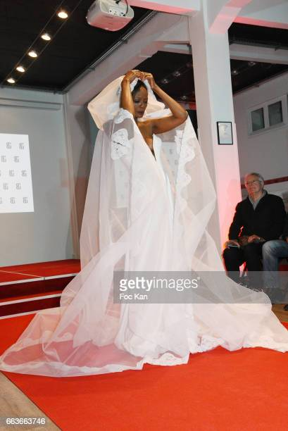 Former Top model Rebecca AyokoÊwalks the runway during Georges Bedran Fashion Show at Espace Batignolles on April 1 2017 in Paris France