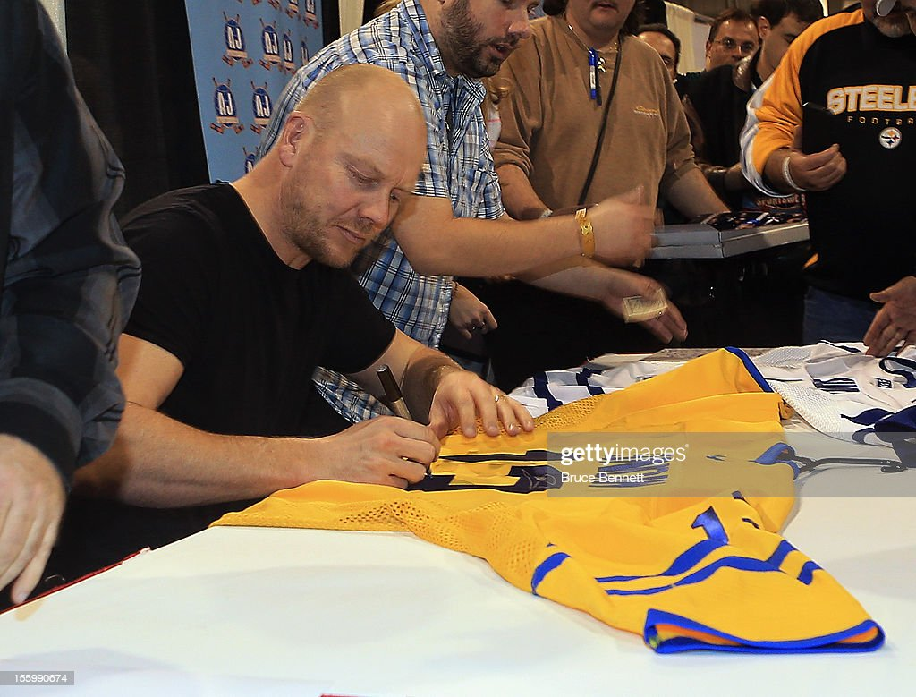 Former Toronto Maple Leaf captain <a gi-track='captionPersonalityLinkClicked' href=/galleries/search?phrase=Mats+Sundin&family=editorial&specificpeople=201858 ng-click='$event.stopPropagation()'>Mats Sundin</a> attends an autograph session at the Sports Card and Memorabilia Expo at the Toronto International Centre on November 10, 2012 in Mississauga, Ontario, Canada. Sundin is set to enter the Hockey Hall of Fame at an induction ceremony on November 12.