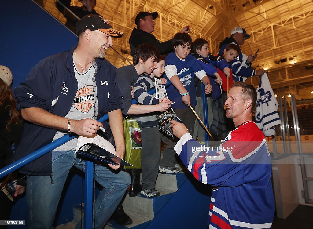 Former Toronto Maple Leaf Gary Roberts signs autographs prior to the 2013 Hockey Hall of Fame Legends Classic game at the Mattamy Athletic Center on November 10, 2013 in Toronto, Canada.