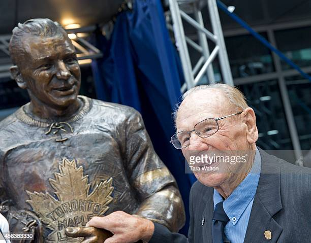 Former Toronto Maple Leaf goalie Johnny Bower has a look at his statue after its unveiling Saturday in Maple Leafs Square Bower along with Darryl...