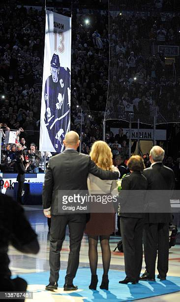 Former Toronto Maple Leafs Captain Mats Sundin takes part in an on ice ceremony with his family as his banner is raised to the rafters prior to NHL...