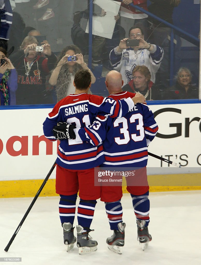 Former Toronto Maple Leafs players Borje Salming and Al Iafrate pose for fans following the 2013 Hockey Hall of Fame Legends Classic game at the Mattamy Athletic Center on November 10, 2013 in Toronto, Canada.
