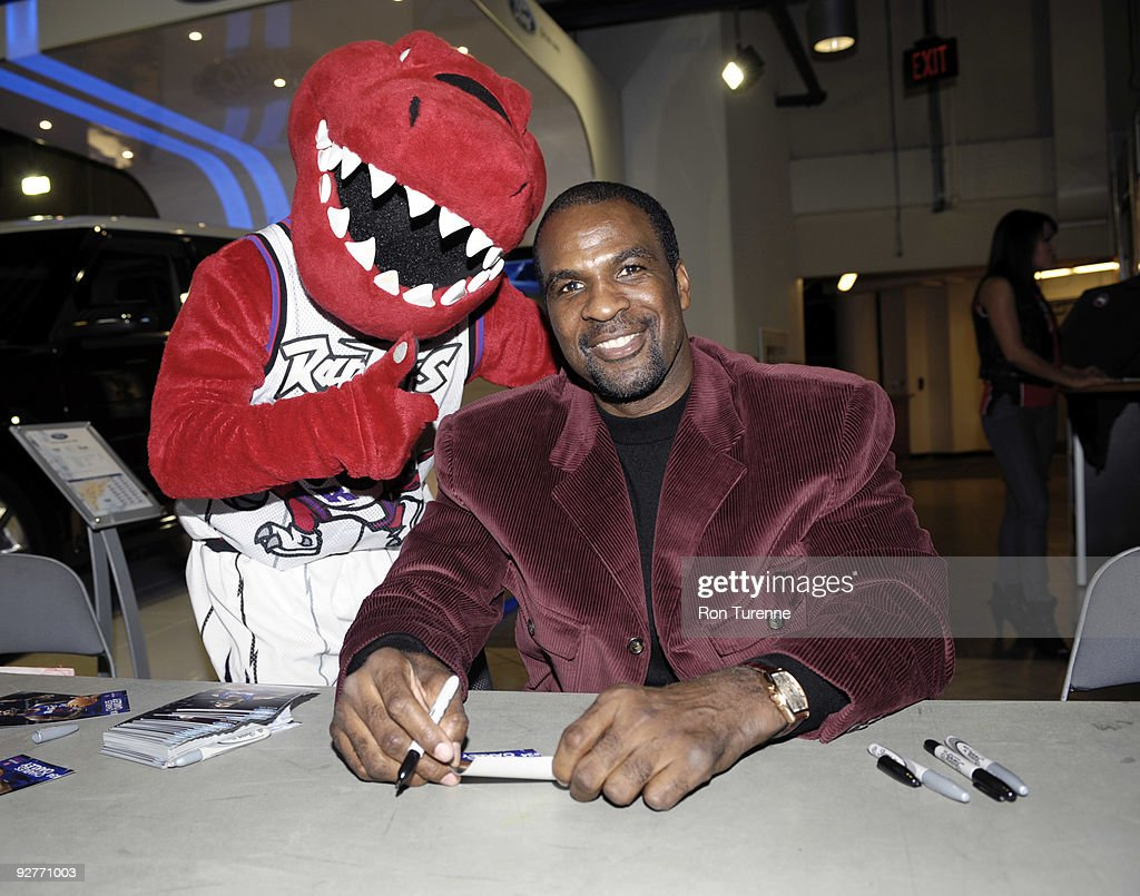 Former Toronto Raptors basketball player <a gi-track='captionPersonalityLinkClicked' href=/galleries/search?phrase=Charles+Oakley&family=editorial&specificpeople=213241 ng-click='$event.stopPropagation()'>Charles Oakley</a> signs autographs for fans to celebrate the Raptors' 15th year of basketball prior to a game against the Detroit Pistons on November 4, 2009 at the Air Canada Centre in Toronto, Ontario, Canada.