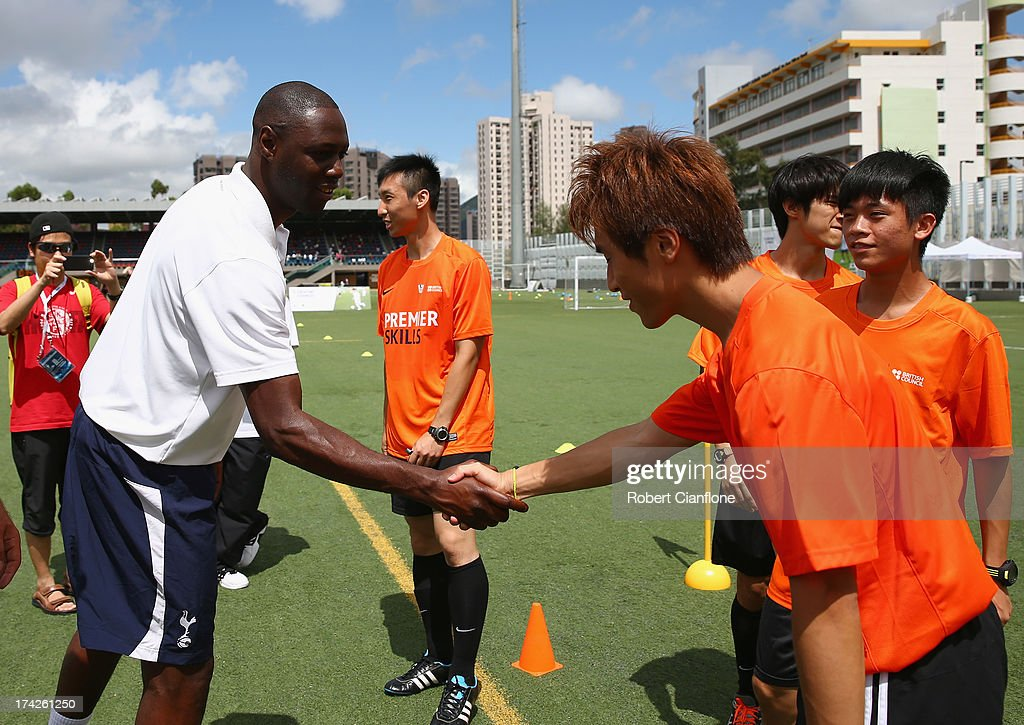 Former Tottenham Hotspur player <a gi-track='captionPersonalityLinkClicked' href=/galleries/search?phrase=Ledley+King&family=editorial&specificpeople=206640 ng-click='$event.stopPropagation()'>Ledley King</a> greets a local referee during the Premier Skills and Creating Chances open day on July 23, 2013 in Hong Kong, Hong Kong.