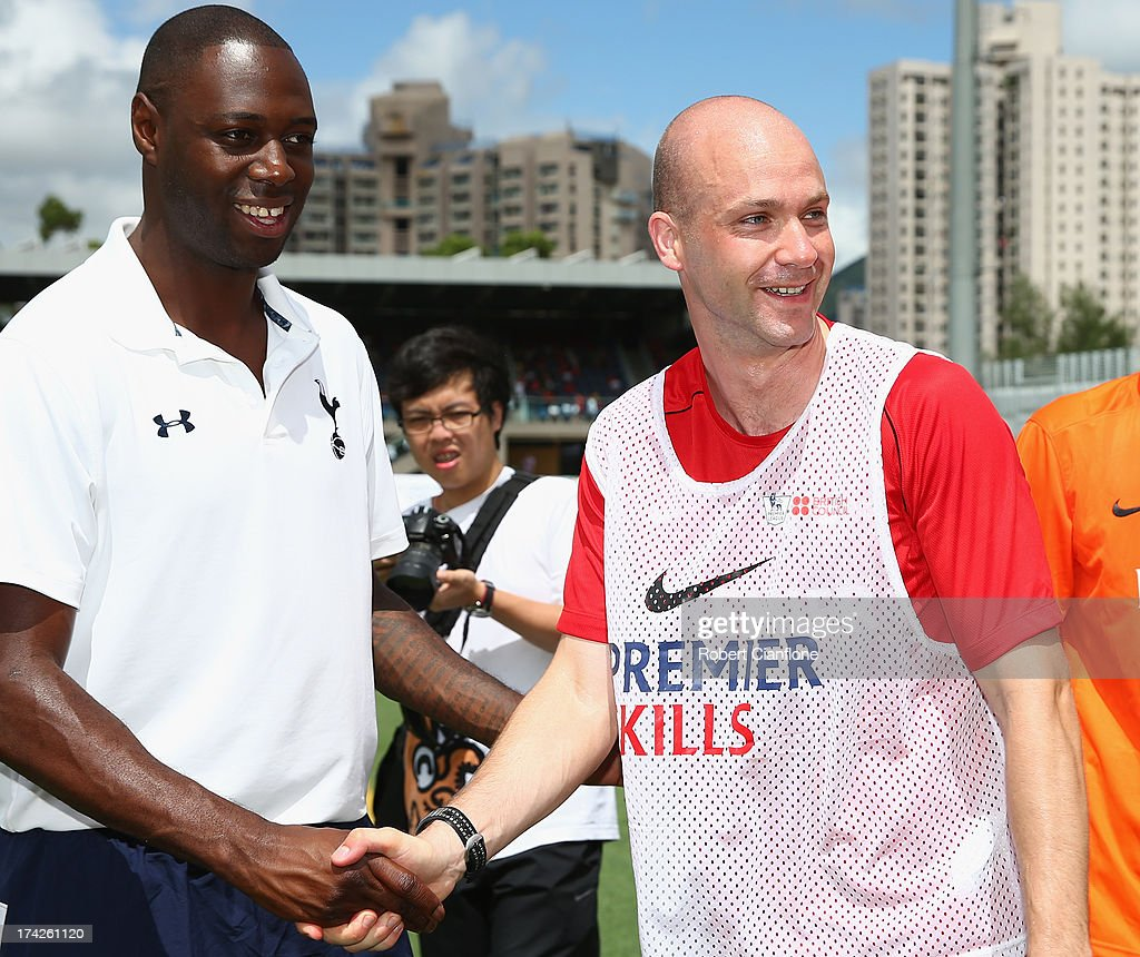 Former Tottenham Hotspur player Ledley King greets referee Anthony Taylor during the Premier Skills and Creating Chances open day on July 23, 2013 in Hong Kong, Hong Kong.