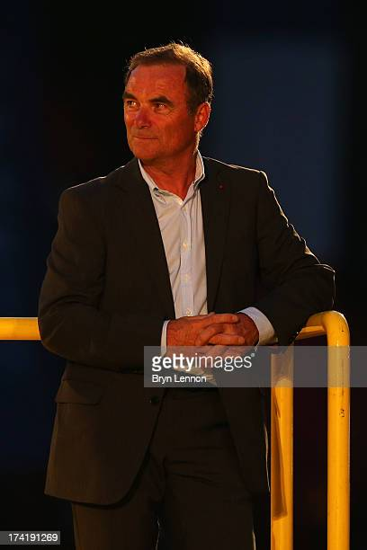 Former Tour winner Bernard Hinault awaits the podium ceremony after after the twenty first and final stage of the 2013 Tour de France a processional...