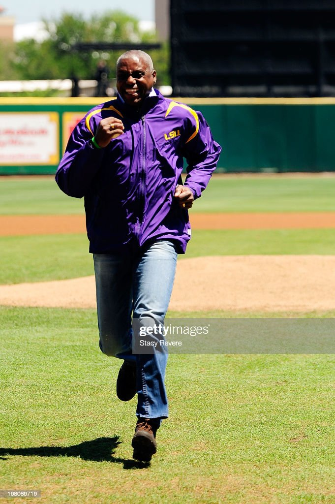 Former Track and Field Olympian, Carl Lewis, throws out the first pitch before a game between the Florida Gators and the LSU Tigers at Alex Box Stadium on May 4, 2013 in Baton Rouge, Louisiana.