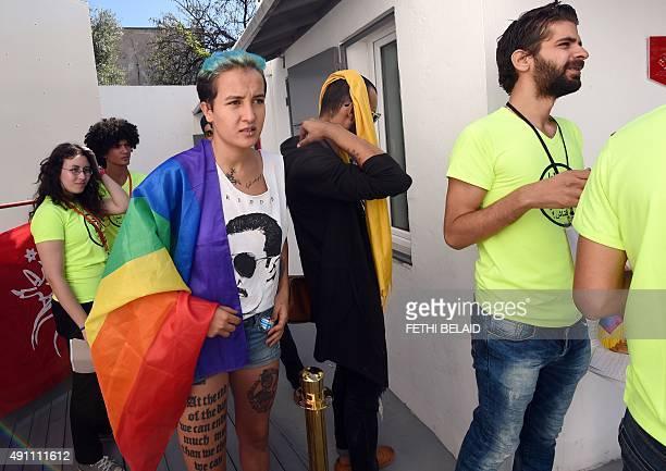 Former Tunisian Femen activist Amina Sboui and members of Tunisian 'Shams' association for the decriminalisation of homosexuality wait before a press...