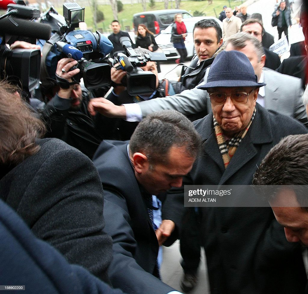 Former Turkish Chief of Staff Ismail Hakki Karadayi (R) arrives at a courthouse in Ankara on January 3, 2013. A prosecutor began questioning Karadayi for his role in the ousting of an Islamic-led coalition government in 1997. Authorities in Turkey have detained a former military chief for his alleged role in a 1997 coup that forced an Islamic-leaning government from power, Anatolia news agency reported on January 3. The retired general, Ismail Hakki Karadayi, is expected to testify before an Ankara court as part of an investigation that was launched in 2011 and has led to the arrests of dozens of military officers.