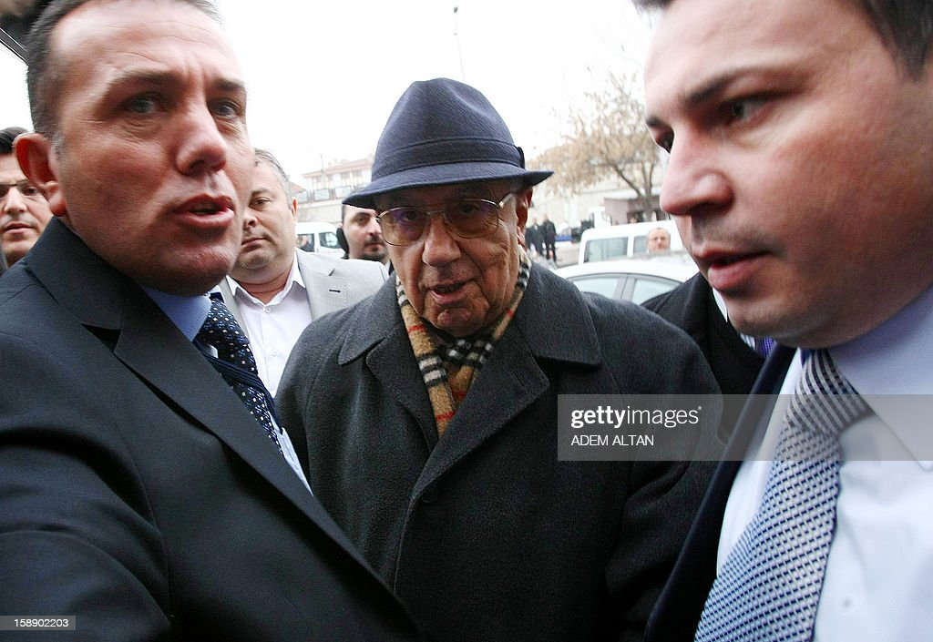 Former Turkish Chief of Staff Ismail Hakki Karadayi (C) arrives at a courthouse in Ankara on January 3, 2013. A prosecutor began questioning Karadayi for his role in the ousting of an Islamic-led coalition government in 1997. Authorities in Turkey have detained a former military chief for his alleged role in a 1997 coup that forced an Islamic-leaning government from power, Anatolia news agency reported on January 3. The retired general, Ismail Hakki Karadayi, is expected to testify before an Ankara court as part of an investigation that was launched in 2011 and has led to the arrests of dozens of military officers.