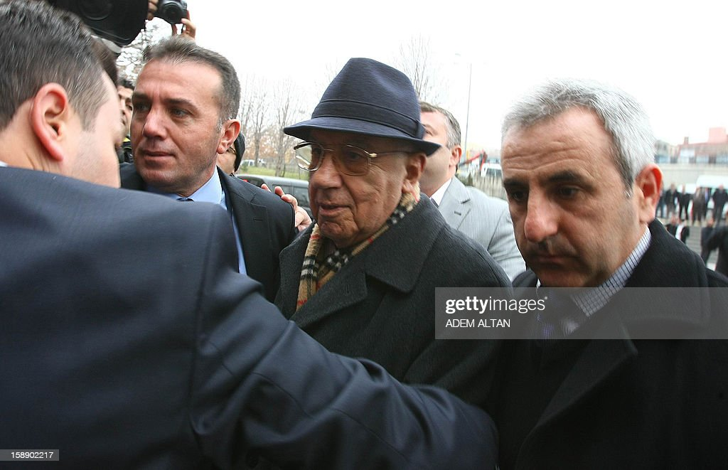 Former Turkish Chief of Staff Ismail Hakki Karadayi (C) arrives at a courthouse in Ankara on January 3, 2013. A prosecutor began questioning Karadayi for his role in the ousting of an Islamic-led coalition government in 1997. Authorities in Turkey have detained a former military chief for his alleged role in a 1997 coup that forced an Islamic-leaning government from power, Anatolia news agency reported on January 3. The retired general, Ismail Hakki Karadayi, is expected to testify before an Ankara court as part of an investigation that was launched in 2011 and has led to the arrests of dozens of military officers. AFP PHOTO / ADEM ALTAN