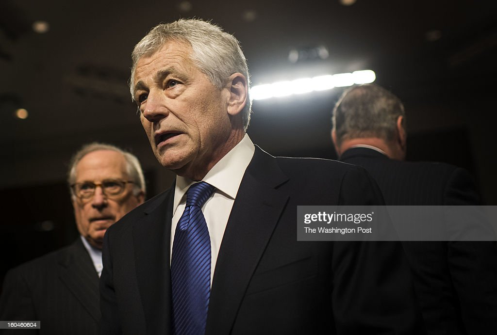 Former two-term Nebraska Republican Senator Chuck Hagel, President Barack Obama's nominee for defense secretary, testifies before the Senate Armed Services Committee on Capitol Hill Thursday, January 31, 2013. Former Senator Democrat Sam Nunn, left, will introduce the nominee.