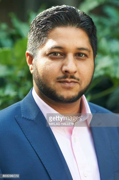 Former Uber driver Yaseen Aslam poses for a photograph outside the Employment Appeals Tribunal in central London on September 28 2017 Uber appealed...