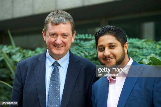 Former Uber drivers James Farrar and Yaseen Aslam pose for a photograph outside the Employment Appeals Tribunal in central London on September 28...