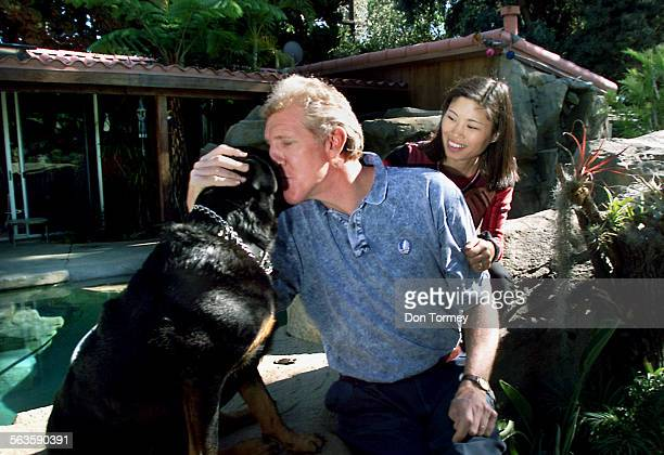 Former UCLA and NBA star center Bill Walton with his wife Lori and dog Annie at their San Diego home Walton the former hippie now TV commentator is...