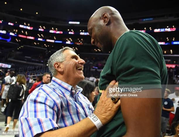 Former UCLA basketball coach Jim Harrick talks with Lamar Odom at the BIG3 at Staples Center on August 13 2017 in Los Angeles California