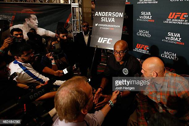 Former UFC middleweight champion Anderson Silva of Brazil interacts with media during the UFC 183 Ultimate Media Day at the MGM Grand Hotel/Casino on...