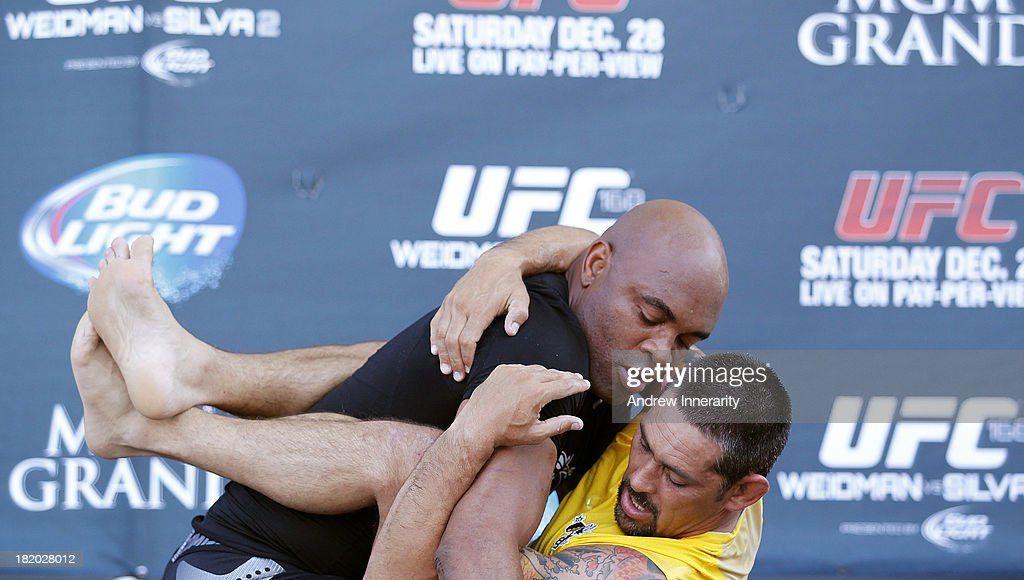 Former UFC middleweight champion Anderson Silva (L) spars with physical therapist Guto Demaske (R) for the media during the UFC 168: Weidman v SIlva 2 press tour at Klipsch Amphitheater at Bayfront Park on September 27, 2013 in Miami, Florida.