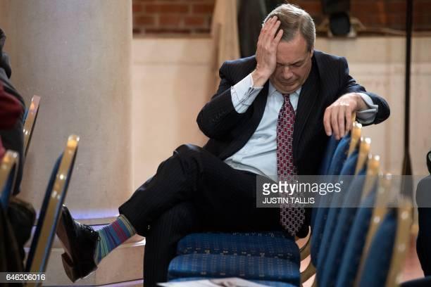 Former UK Independence Party leader Nigel Farage sits in the audience during a press conference in London on February 28 2017 A bitter row broke out...