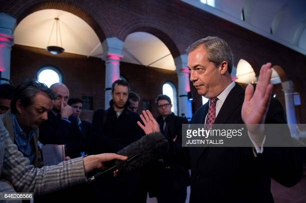 Former UK Independence Party leader Nigel Farage speaks to members of the media at at a press conference to launch a paper on the impact of Brexit on...