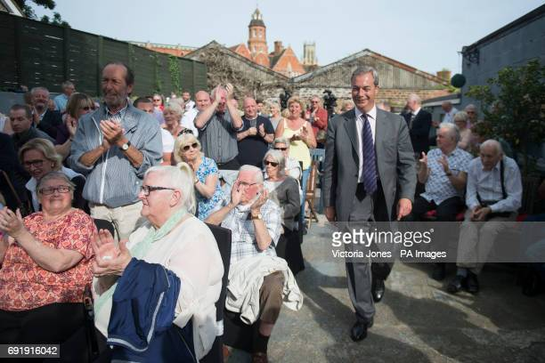 Former Ukip leader Nigel Farage enters a UKIP meeting in Ramsgate while on the general election campaign trail in South Thanet