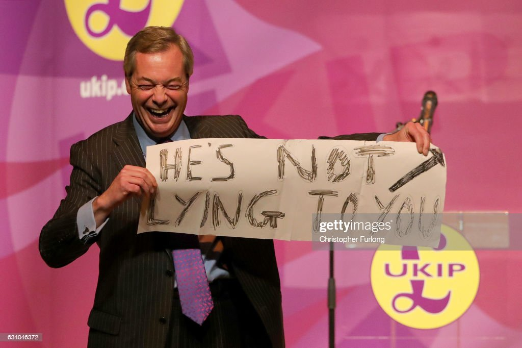 Former UKIP Leader, Nigel Farage MEP holds a sign during a public meeting on February 6, 2017 in Stoke, England. The Stoke-on-Trent central by-election has been called after sitting Labour MP Tristram Hunt resigned from his seat to be a museum director. The seat has always been a Labour stronghold but will see fierce competition from The United Kingdom Independence Party (UKIP) as they target people who voted for Brexit and the tradtional Labour working classes.