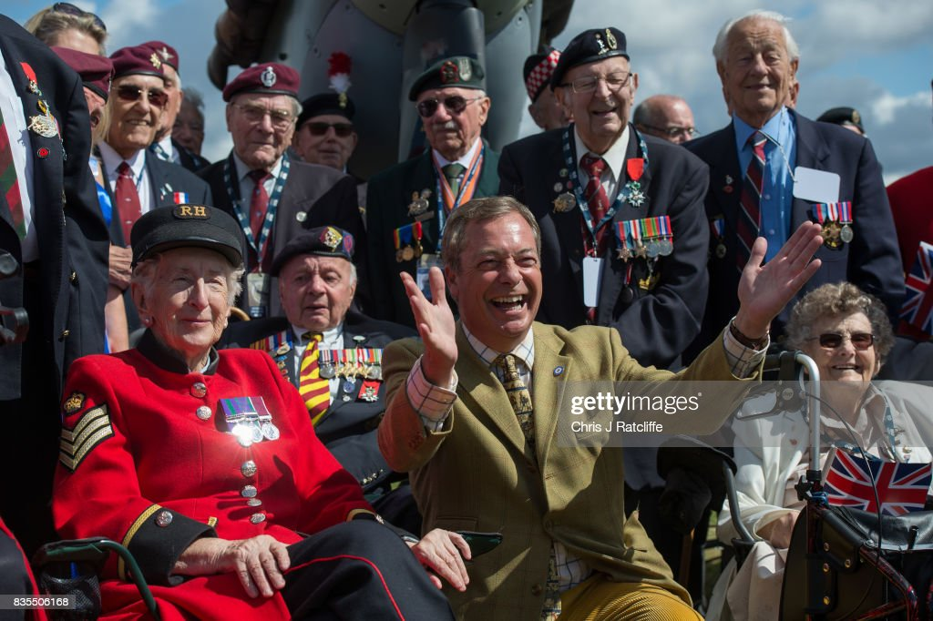 Former UKIP leader Nigel Farage poses for photographs with veterans and Chelsea Pensioners next to a Spitfire on display at the Biggin Hill Festival of Flight on August 19, 2017 in Biggin Hill, England. The Biggin Hill Festival of Flight is an annual airshow event and in 2017 the airport is celebrating its centenary. The airport only became exclusively business and general aviation in 1959, prior to which it was used by the British Royal Air Force.