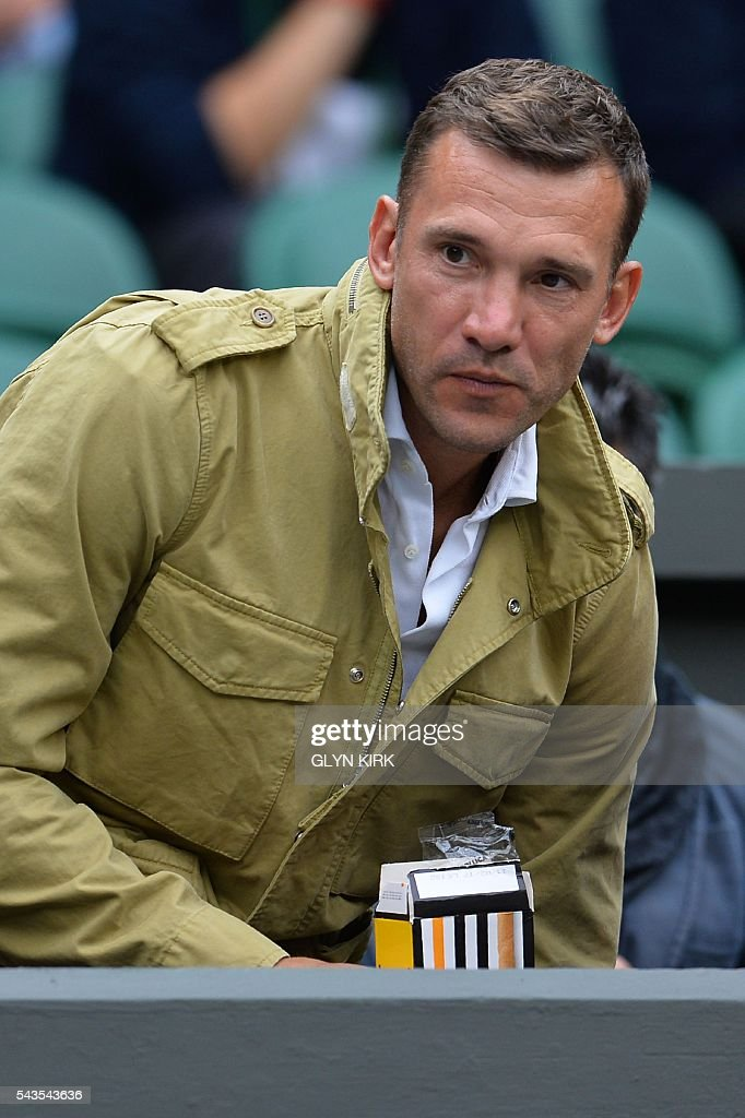 Former Ukrainian footballer Andriy Shevchenko sits on centre court to watch Serbia's Novak Djokovic play against France's Adrian Mannarino during their men's singles second round match on the third day of the 2016 Wimbledon Championships at The All England Lawn Tennis Club in Wimbledon, southwest London, on June 29, 2016. / AFP / GLYN