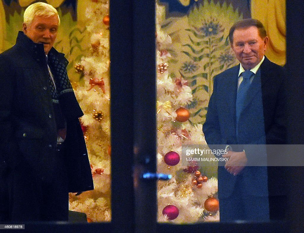 Former Ukrainian president <a gi-track='captionPersonalityLinkClicked' href=/galleries/search?phrase=Leonid+Kuchma&family=editorial&specificpeople=239079 ng-click='$event.stopPropagation()'>Leonid Kuchma</a> (R) and Russian ambassador to Belarus Alexander Surikov (L) arrive for a new round of talks on resolving the Ukraine conflict in Minsk on December 24, 2014. Ukranian and rebel envoys resumed intense talks aimed at ending a pro-Russian uprising that has left the ex-Soviet republic in ruins and upset East-West ties.