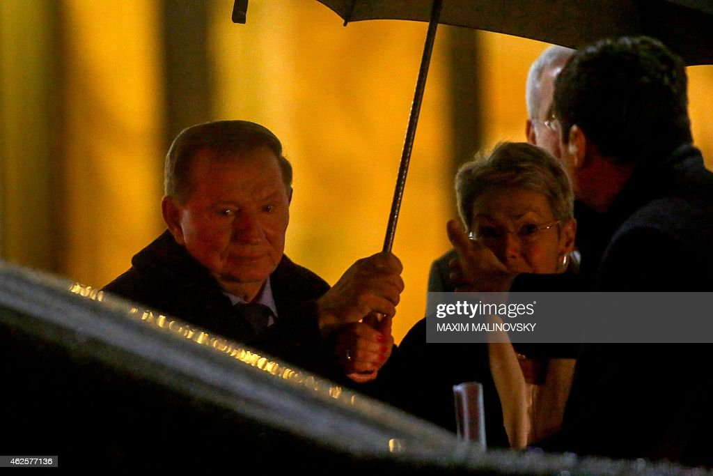 Former Ukrainian President <a gi-track='captionPersonalityLinkClicked' href=/galleries/search?phrase=Leonid+Kuchma&family=editorial&specificpeople=239079 ng-click='$event.stopPropagation()'>Leonid Kuchma</a> (L) and the Organization for Security and Cooperation in Europe (OSCE) envoy, Swiss Heidi Tagliavini (R) leave the presidential residence in Minsk after talks aimed at ending the fighting in east Ukraine on January 31, 2015. Kiev's pro-Western leaders and mediators hoped to reach a 'binding' truce with pro-Russian separatists Saturday despite Ukraine suffering one of its bloodiest days yet in the nine-month conflict with 15 troops killed.