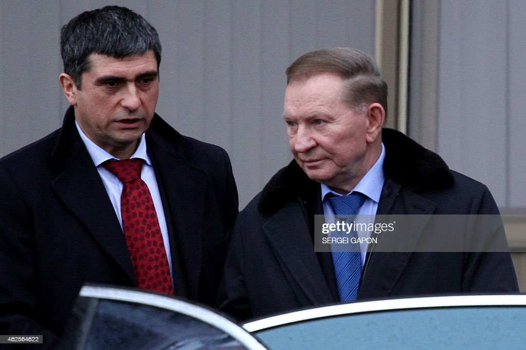Former Ukrainian President <a gi-track='captionPersonalityLinkClicked' href=/galleries/search?phrase=Leonid+Kuchma&family=editorial&specificpeople=239079 ng-click='$event.stopPropagation()'>Leonid Kuchma</a> (R) arrives at Minsk airport on January 31, 2015 for talks aimed at ending the fighting in east Ukraine. Kiev's pro-Western leaders and mediators hoped to reach a 'binding' truce with pro-Russian separatists on January 31 despite Ukraine suffering one of its bloodiest days yet in the nine-month conflict with 15 troops killed. Man at left is an unidentified aide.