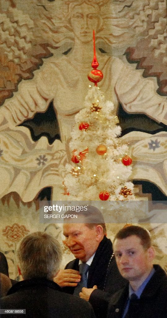 Former Ukrainian president <a gi-track='captionPersonalityLinkClicked' href=/galleries/search?phrase=Leonid+Kuchma&family=editorial&specificpeople=239079 ng-click='$event.stopPropagation()'>Leonid Kuchma</a> arrives for a new round of talks on resolving the Ukraine conflict in Minsk, on December 24, 2014. Ukranian and rebel envoys resumed intense talks aimed at ending a pro-Russian uprising that has left the ex-Soviet republic in ruins and upset East-West ties.