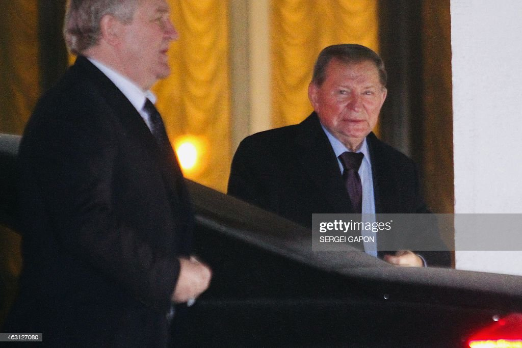 Former Ukrainian President <a gi-track='captionPersonalityLinkClicked' href=/galleries/search?phrase=Leonid+Kuchma&family=editorial&specificpeople=239079 ng-click='$event.stopPropagation()'>Leonid Kuchma</a> (R) arrives on February 10, 2015 in Minsk for talks aimed at ending the bloody conflict in eastern Ukraine ahead of a high-profile summit between Ukraine, Russia, Germany and France.