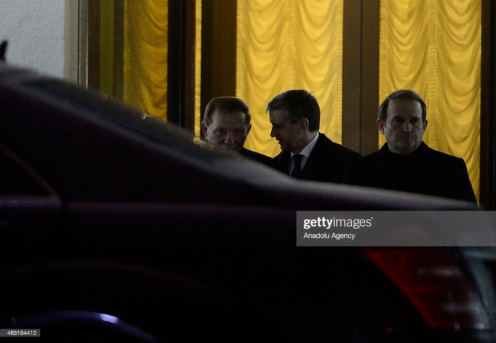 Former Ukrainian President <a gi-track='captionPersonalityLinkClicked' href=/galleries/search?phrase=Leonid+Kuchma&family=editorial&specificpeople=239079 ng-click='$event.stopPropagation()'>Leonid Kuchma</a> (L) leaves the presidential residence after peace talks over the situation in east Ukraine on February 10, 2015 in Minsk, Belarus.