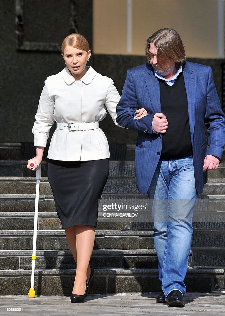 Former Ukrainian prime minister and opposition leader <a gi-track='captionPersonalityLinkClicked' href=/galleries/search?phrase=Yulia+Tymoshenko&family=editorial&specificpeople=546280 ng-click='$event.stopPropagation()'>Yulia Tymoshenko</a> (L) arrives, accompanied by her ally Ukrainian journalist Oleksandr Abdulling, for a press conference in Kiev on March 27, 2014. Ukraine's formerly jailed divisive opposition icon <a gi-track='captionPersonalityLinkClicked' href=/galleries/search?phrase=Yulia+Tymoshenko&family=editorial&specificpeople=546280 ng-click='$event.stopPropagation()'>Yulia Tymoshenko</a> completed an improbable return to politics on March 27 following her release on February 22, by confirming plans to run for president in elections on May 25.