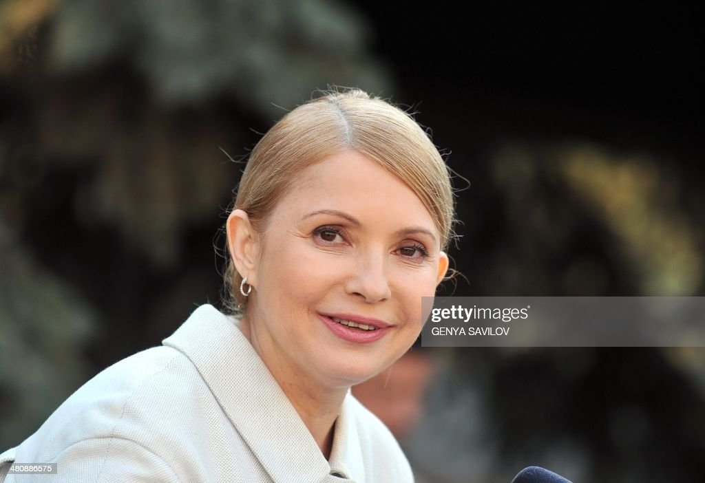 Former Ukrainian prime minister and opposition leader <a gi-track='captionPersonalityLinkClicked' href=/galleries/search?phrase=Yulia+Tymoshenko&family=editorial&specificpeople=546280 ng-click='$event.stopPropagation()'>Yulia Tymoshenko</a> smiles during a press conference in Kiev on March 27, 2014. Ukraine's formerly jailed divisive opposition icon <a gi-track='captionPersonalityLinkClicked' href=/galleries/search?phrase=Yulia+Tymoshenko&family=editorial&specificpeople=546280 ng-click='$event.stopPropagation()'>Yulia Tymoshenko</a> completed an improbable return to politics on March 27 after her release on February 22 by confirming plans to run for president in elections on May 25. AFP PHOTO/GENYA SAVILOV